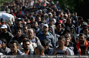 2017-09-21-14-23-19-getty20-20migranten