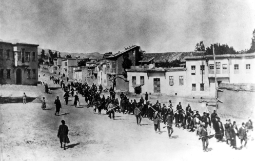 Ottoman Armenians are marched to a prison in Kharpert, Armenia by armed Turkish soldiers in April 1915.